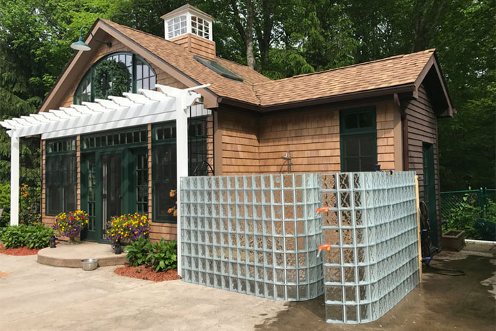 Pool house glass block shower | Innovate Building Solutions