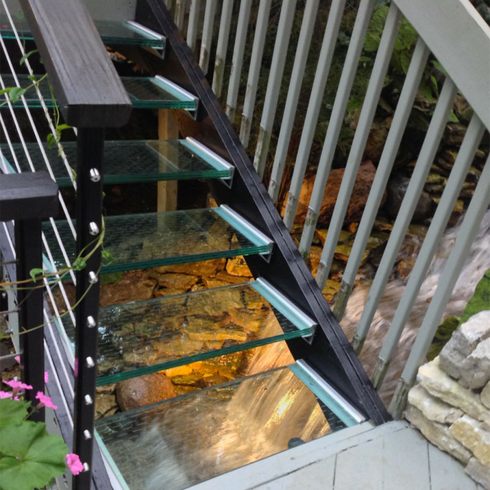 Water running under glass treads A McClure | Innovate Building Solutions