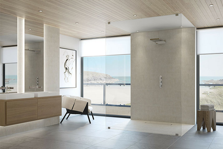 Sleek contemporary shower with a barrier free curbless entry, wall mounted cabinetry and large format tiles | Innovate Building Solutions