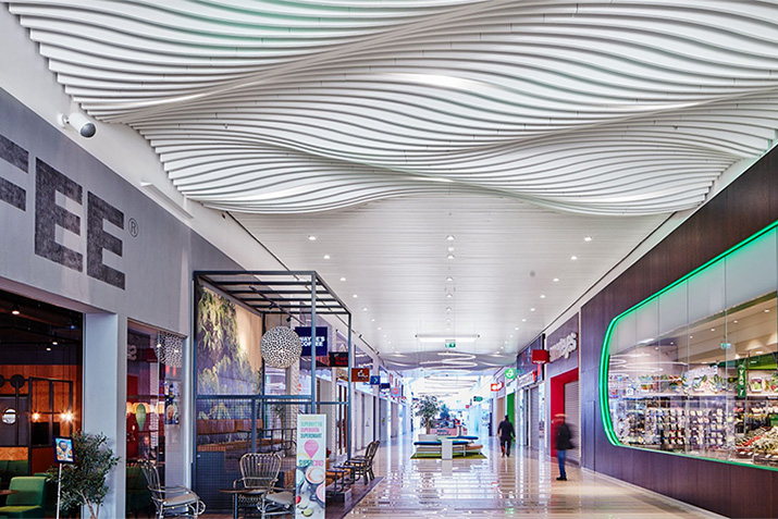 Acoustical design for open spaces with creative alternatives to suspended ceilings