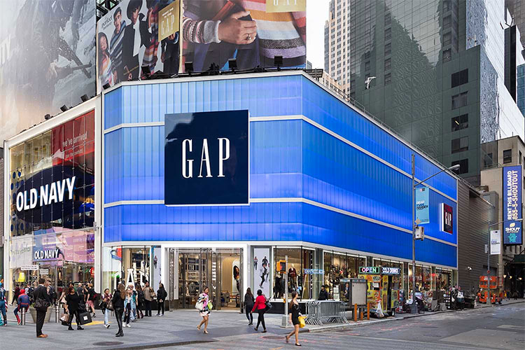The Gap store in Times Square, NYC. The blue facade is EXTECH's LIGHTWALL 3440 translucent wall system coupled with custom-colored polycarbonate. Image by Vanni Archive Architectural Photography