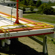 BlueWater, the original creators of the collapsible rooftop guardrail, Stealthrail