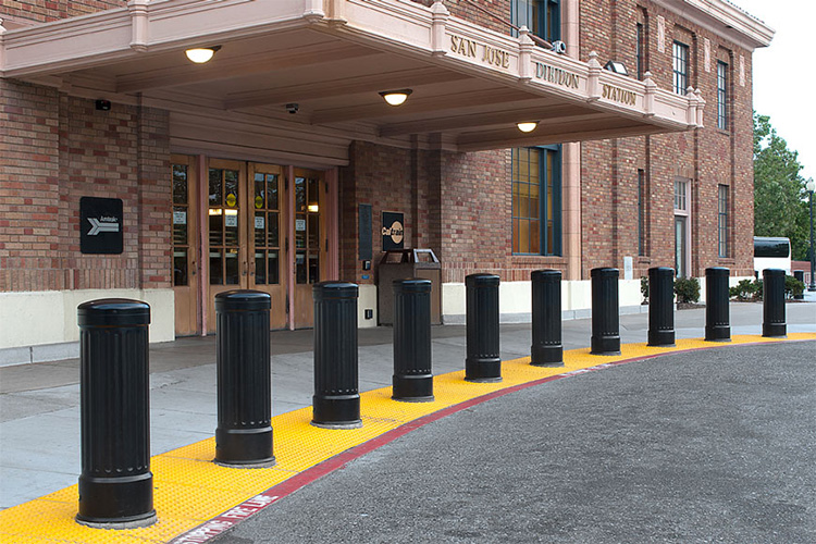 This protective line of bollards protects accessible pedestrian space from the road.