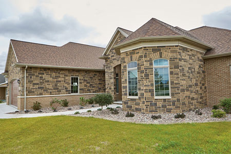 This home features a custom blended pattern of the new Devotion and Promise Reflection Stone Masonry Unit colors
