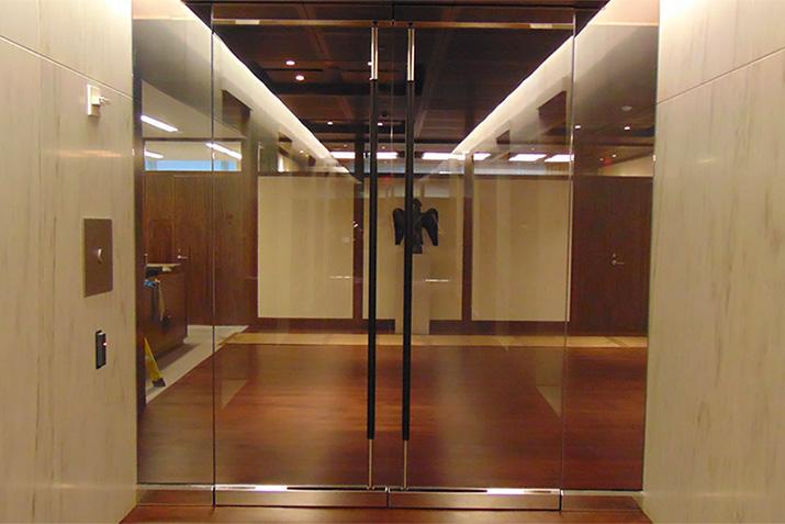 Glass door security options: developing an all-glass bulletproof door