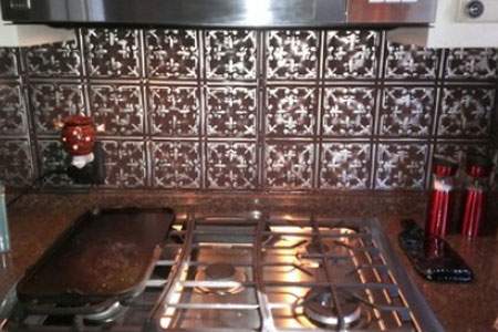 Liven Up Your Pool House with A Metal Tile Backsplash and Ceiling Tiles to Match