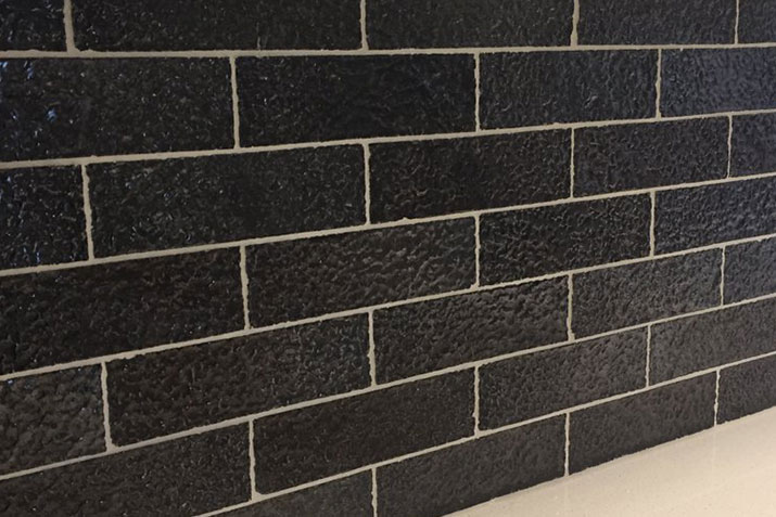 Metallic black is a dazzling new face brick