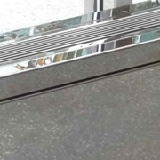 Mirror polished stainless steel enclosure top and return grilles at New York City Hospital Lobby