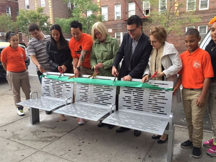 NYC DOT and other local stakeholders marked the installation of the 1,500th CityBench at Jordan L. Mott Middle School 22 in the Bronx with a ribbon cutting. Six new CityBenches were recently installed as part of a community beautification project at the school. (Courtesy NYC DOT)