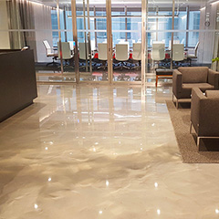 The Reflector™ Enhancer Flooring System - a specialty, high build, self-leveling, fluid-applied floor coating