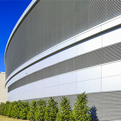 Wind-driven rain resistant stationary louvers